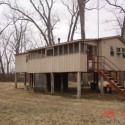 Hunting cabin with bathroom overlooking Whitehall Lake is included in the purchase.